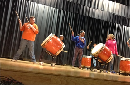 Students playing African Drums